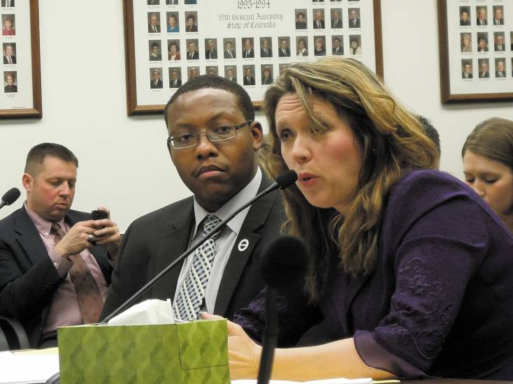Rep. Jovan Melton, D-Aurora, listens as Shelley Forney speaks in support of his legislation that sought to ban most uses of cell phones while driving. The bill failed in the House Transportation and Energy Committee on March 12. Photo by Vic Vela