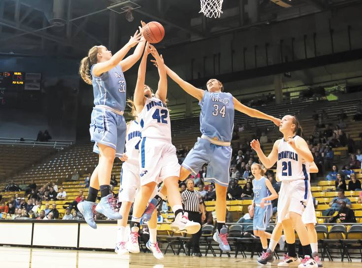 Valor Christian defenders Kendall Bradbury (32) and Kylie Rose (34) block a shot attempt from Broomfield's Stacie Hull (42) during the Eagles' 67-46 loss in the Class 4A semifinals March 13 at the CU Events Center in Boulder.