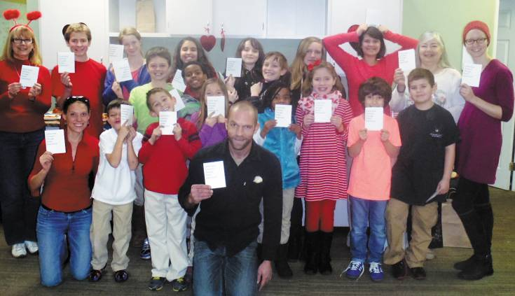 "Students and staff at Woodlands Academy, 1057 Park St., recently have been involved in a smile experiment, giving ""thank you"" cards to people who smile at them. Courtesy photo"