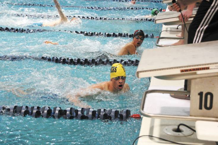 Wheat Ridge�s Max Sweeney looks for his time and how his team finished their 200 Medley Relay during Saturday�s Dick Rush Memorial Swim-Dive Invitational.