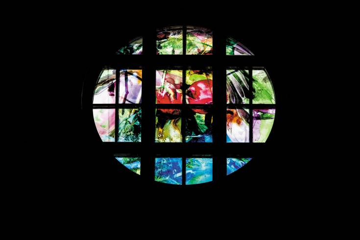 """Spring"" window, just installed at Our Lady of Loreto Church, is designed by Scott Larson. One can see crystal waters, a Tree of Life, pomegranate, cherry, palm frond."
