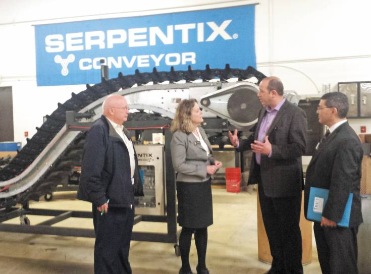 From left,  Bob Briggs, Westminster city councilor, Robert Nusz, president of Serpentix Conveyor, Representative Tracy Kraft-Tharp and Alberto Garcia, Westminster City councilor discuss the progress of Westminster business Serpentix Conveyor during a business tour led by Kraft-Tharp on March 21.