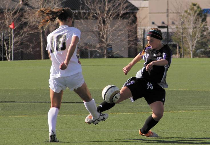 Douglas County's Kate Leachman wins the battle for the ball against Rock Canyon defender Emily Postma April 17 at Shea Stadium. Postma's team got the best of Hargrove's, however, winning the Continental League match, 3-0.