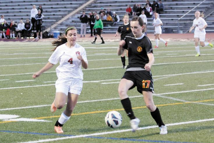 Castle View midfielder Grace Perry (17), right, moves to protect the ball from Faith Lucas (4) of Heritage April 15. The Eagles won the league contest, 2-1.