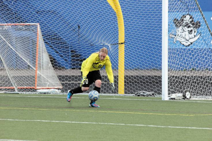 Englewood High School soccer goalie Miranda Holman scoops up a shot at the goal during the April 24 game against Weld Central. The game in a scoreless tie, marking the 12th time this season the Pirates haven't given up a goal.
