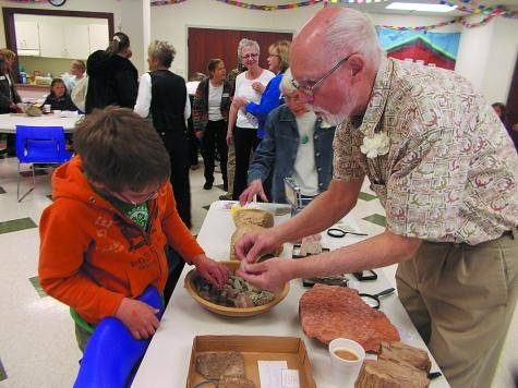 One popular draw at the Florissant Public Library's 10th anniversary party on April 26 was the fossil and geology table manned by Bob Carnein, a member of the Lake George Gem & Mineral Club.