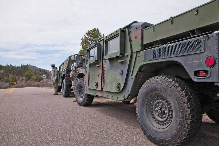 Spc. Andrew Senphannarat and Sgt. Anthony Arrieta with the Colorado National Guard keep watch during an interagency wildfire drill near the Happy Canyon subdivision in Castle Pines on May 3.