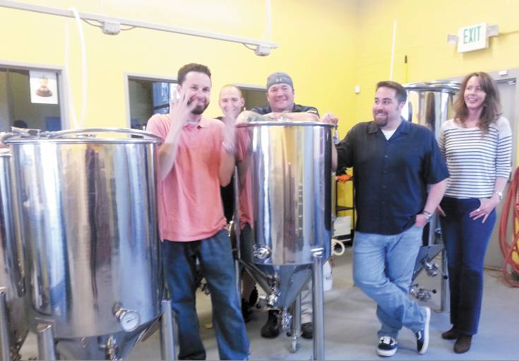 (From left) Brett Blazek, Lael Callaway, Mike Keating, Jason Virzi and Kim Keating are brewing up big plans for their new venture, 38 State Brewing Company.