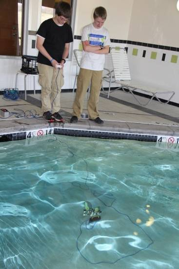 A remote control is attached with CAT 5 cable that the engineers use pilot the underwater vessel.