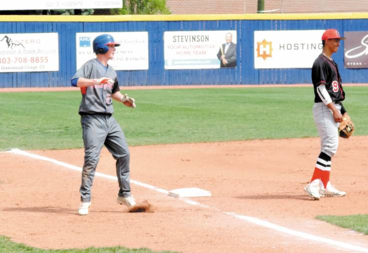 Ryan Robb stops at third base with a triple during Cherry Creek's five-run third inning in the Bruins' 10-0 win over Eaglecrest May 3.