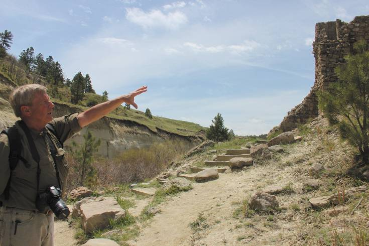 Ron Claussen, president of the Friends of Castlewood Canyon, points out the crumbling remnants of the dam, which broke in 1933, flooding Denver and all points in between.