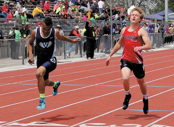 Valor Christian freshman Vincent Hood, left, crosses the finish line in the May 15 100 meter prelims just .08 seconds ahead of Elizabeth senior Joel Thies. The two finished four-five in the heat and both advanced to the Class 4A finals in Lakewood.