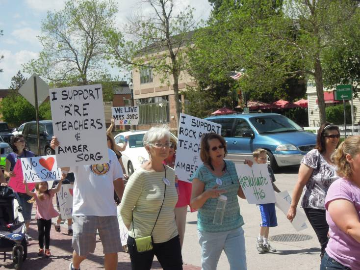 Supporters of Rock Ridge Elementary School teachers and principal Amber Sorg march on the school district's administration building in Castle Rock on May 20. Photo by Mike DiFerdinando