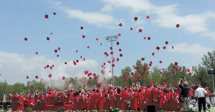 Heritage High's Class of 2014 caps off its graduation ceremony on May 22, 2014 at the Littleton Public Schools Stadium.