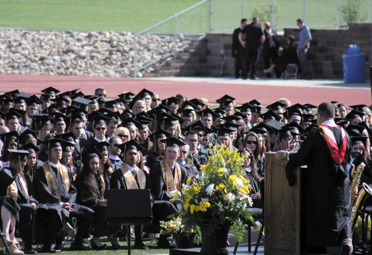 Principal Andy Abner speaks to the class of 2014 at Rock Canyon High School�s graduation May 23 at Sports Authority Stadium.