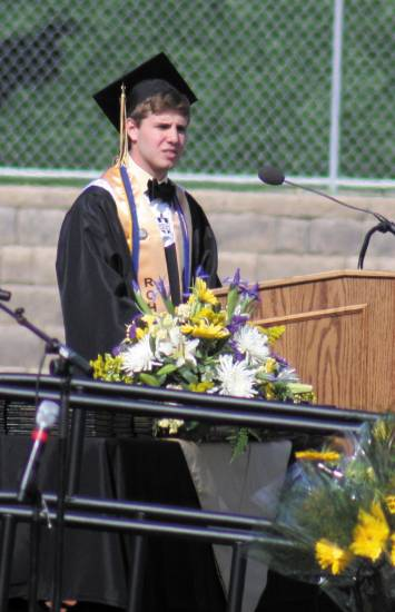 Maxwell Pederson gives the class address at Rock Canyon High School�s graduation May 23 at Sports Authority Stadium.