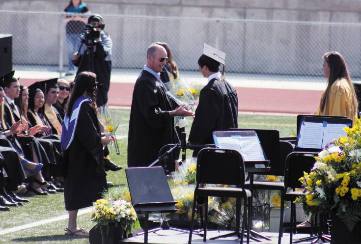 Students received their diplomas at Rock Canyon High School�s graduation May 23 at Sports Authority Stadium.