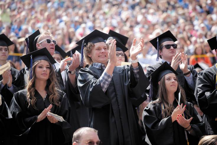 Graduates stand and cheer after a performance from fellow seniors during the Highlands Ranch High School commencement ceremony at Red Rocks Amphitheater on May 21.