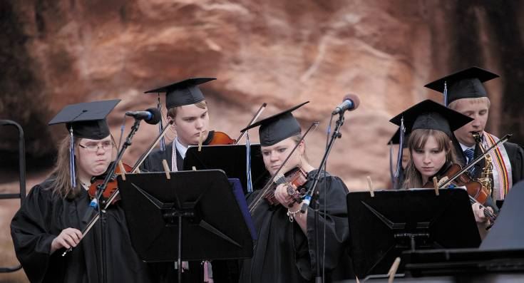 Band members perform the national anthem during Highlands Ranch High School's graduation ceremony at Red Rocks Amphitheater on May 21.