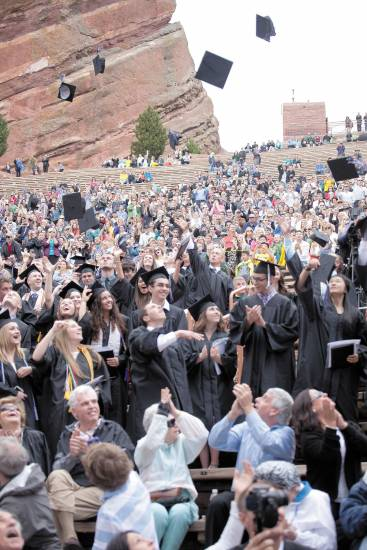 Seniors toss their hats into the air at the Highlands Ranch High School commencement ceremony at Red Rocks Amphitheater on May 21.