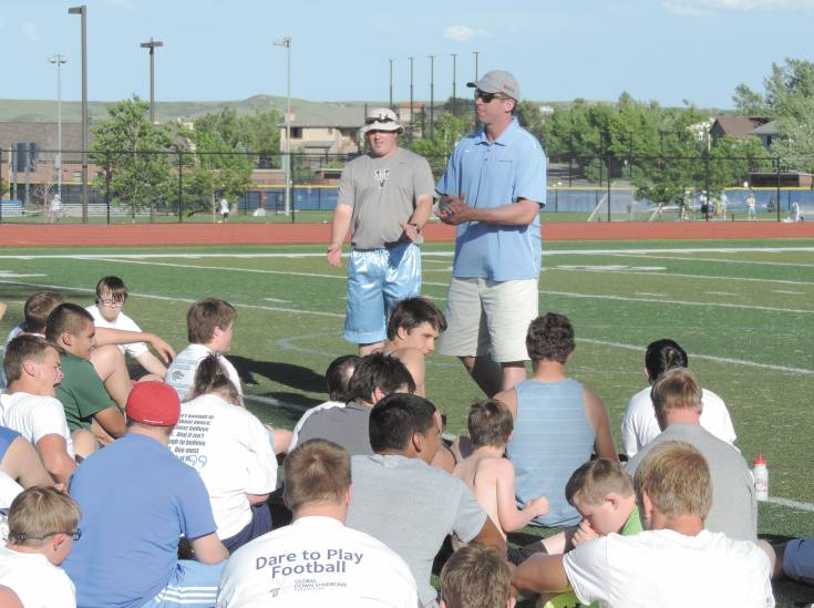 Former Denver Bronco Ed McCaffrey talks to players during Valor Christian's Dare to Play camp.