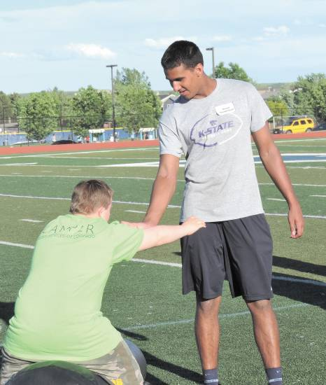 Daniel Hendrickson, left, works out with Valor Christian senior Sabastian Sock, during the Valor Christian Dare to Play camp this past week