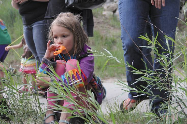 A young fan uses a duck whistle during the 2014 Ducky Derby at Plum Creek in Castle Rock.
