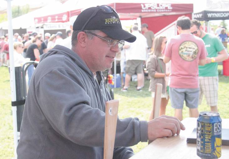 John Turk, who serves as the Colorado sales manager of Salt Lake City-based brewery Epic, served up plenty of the brewery�s IPA and pilsner June 7. Epic was one of 48 breweries present at the sold-out festival in Highlands Ranch.