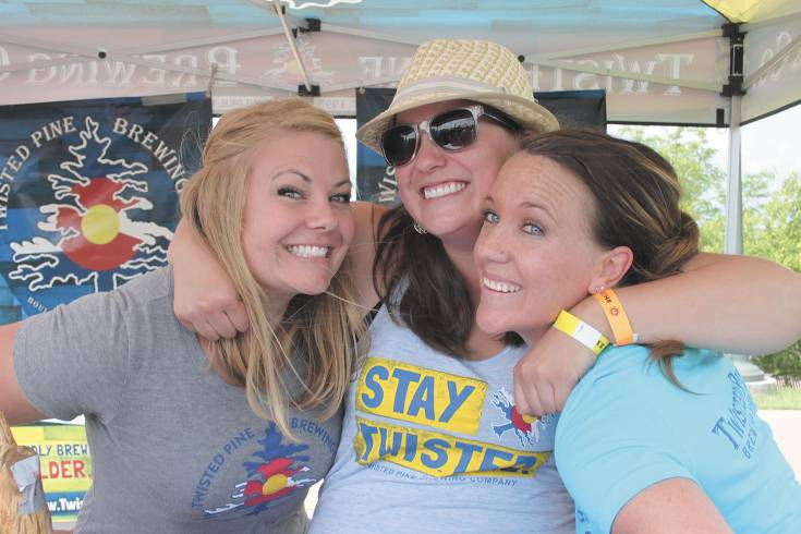 Work? From left, Bri Olinger, Val Lark and Katie WesterKamp of the Boulder brewery, Twisted Pine, were caught having about as much fun as you can while on the job at the June 7 Highlands Ranch Beer Fest.