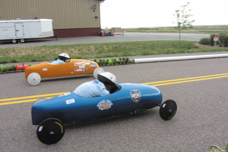 Super stock finalists Aly Corvin and Camden Martin compete for first place in the Sertoma Mile High Soap Box Derby at the Arapahoe County Fairgrounds on June 22.