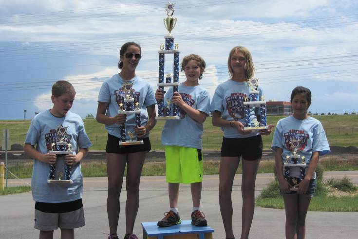 The top five super stock racers pose with their trophies. From left to right: Adam Smith (fourth place), Aly Corvin (second place), Camden Martin (first place), Clare Mahoney (third place), Elena Martinez (fifth place).