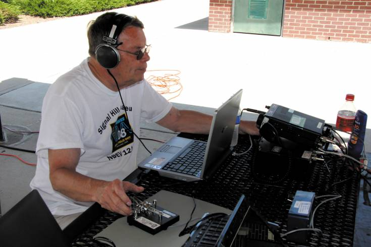 A member of the Littleton Radio Amateurs uses Morse Code to send a message during last year's annual 24-hour field day event, A number of the amateur radio operators will again set up their station at Cornerstone Park for the exercise that begins at noon June 27.