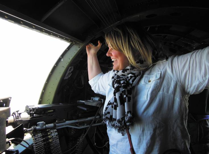 "Angie Hottinger takes in the view from a B-17 as part of ""Aviation Week"" at Centennial Airport. The activities benefit the Colorado Aviation Business Association's scholarship program and the airport's foundation. Photo by Chris Michlewicz"