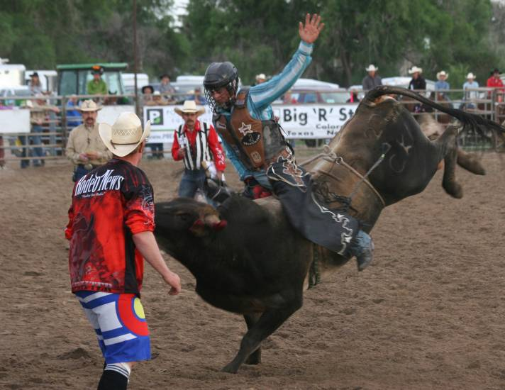 Cody Tesch participates in the bull riding competition at the Cowboy Up in Kiowa Rodeo on June 27.