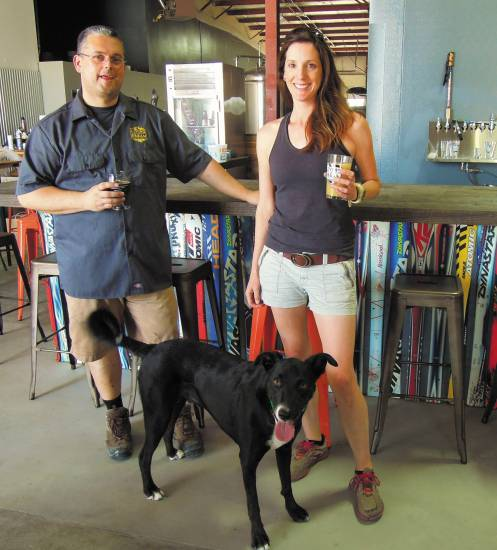 Jason Bell, Carrie Knose and brewery dog Otto are ready to welcome beer lovers to Douglas County's newest tasting room, Living the Dream.