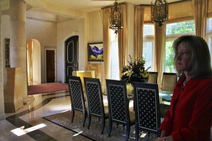 Christine Battista, a real estate agent for Keller Williams DTC Luxury International, shows the main dining room of Serenity Ridge, a three-level home on more than 70 acres southeast of Parker.