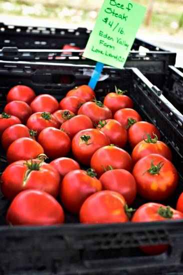 Hearty beefsteak tomatoes are among the many locally grown finds at the Centennial Artisan and Farmers Market. The monthly event is held every second Saturday through August.