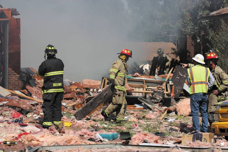 Fire crews sift through the debris after an explosion leveled the home at 13072 Monroe Drive, killing a man, and damaging five other houses on June 19. Nearly a month later, city of Thornton officials hosted a community meeting to update neighbors on the investigation into the cause and cleanup efforts and eliminate asbestos exposure concern.