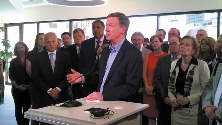 Gov. John Hickenlooper speaks out against ballot initiatives that would place restrictions on oil and gas operations during a July 17 press conference in downtown Denver. The governor was joined by several leaders in politics, business and the energy industry.