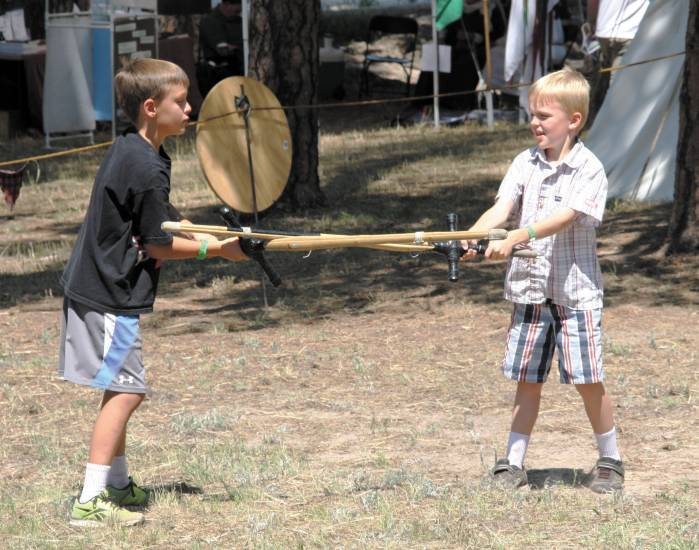 Brothers Pearce and Dawson Winsor battle with claymores at the Elizabeth Celtic Festival on July 20.