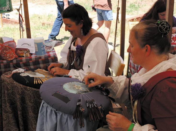 Darla Landfair, right, and Carey Lowe-Curry perform a bobbin lace demonstration at the Elizabeth Celtic Festival on July 20.