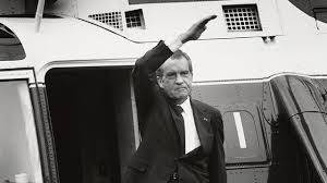 U.S. President Richard Nixon stands on the steps of the presidential helicopter as he waves goodbye to the White House for the final time.