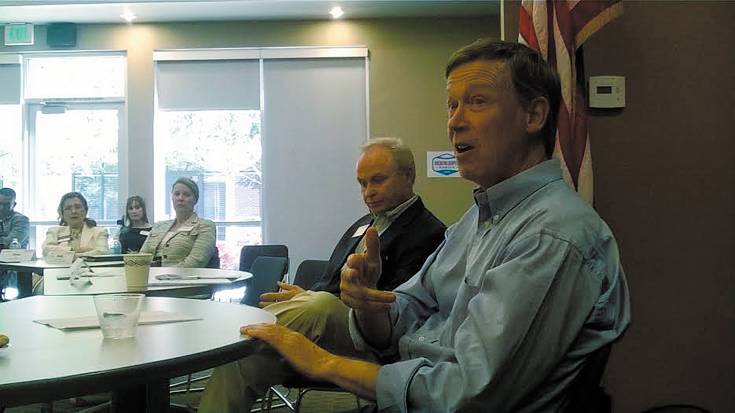 Gov. John Hickenlooper speaks during an Aug. 8 round table discussion with business leaders at the South Metro Denver Chamber of Commerce in Centennial.
