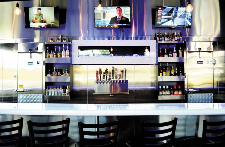 At the bar, guests can sip a variety of flaming and nitrogen-infused drinks, as well as a pint of Colorado craft beer.