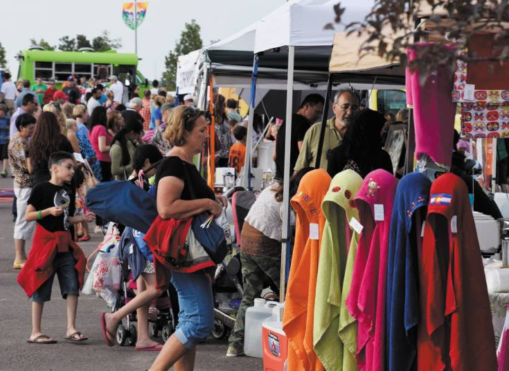The Centennial Artisan and Farmers Market attracted thousands of visitors as it helped lead off the Centennial Under the Stars event on Aug. 9.