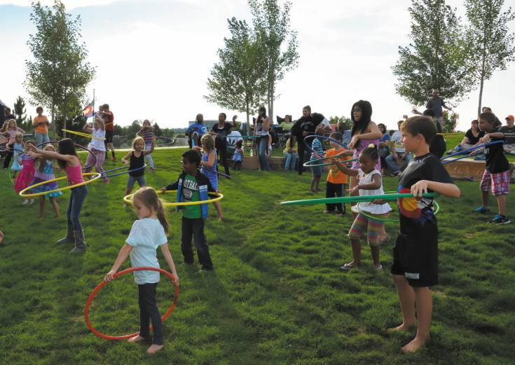 Kids enjoy some hula hoop fun Aug. 9 during the beginning of the 9th Annual Centennial Under the Stars event.