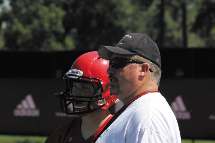 Elizabeth coach Chris Cline talks with senior quarterback Willie Weber during a 7-on-7 tournament in June. File photo