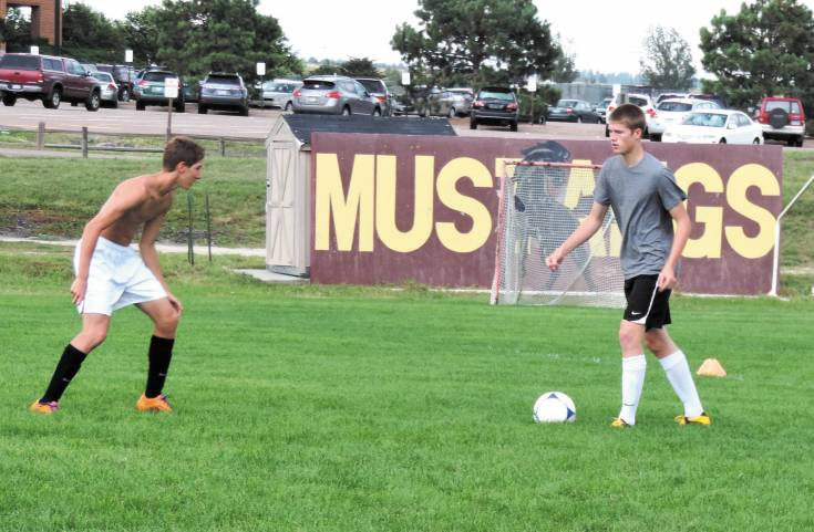 Lars Peterson, right, puts the moves on a Ponderosa teammate Colin Hester on Aug. 14 at practice. Peterson scored seven goals and had 22 total points for the Mustangs last fall.