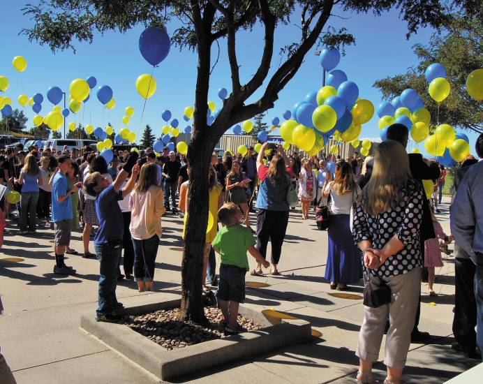 The 344 students and guests at Parker's Colorado Early Colleges wait to release balloons as part of the school's Aug. 18 opening ceremony. Photo by Jane Reuter