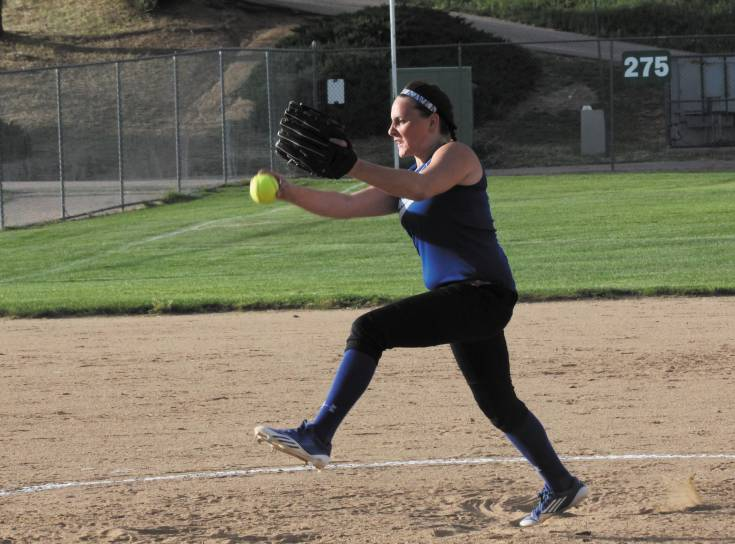 Englewood pitcher Brittany Hall delivers a strike during a summer league game against Sheridan in July. Hall joins a number of returning letter winners for the Pirates, who began the fall prep softball season Aug. 19 at Weld Central.